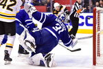 Toronto Maple Leafs goaltender Frederik Andersen (31) makes a big save during third period NHL round one playoff hockey action against the Boston Bruins in Toronto on Monday, April 16, 2018. (Frank Gunn/The Canadian Press via AP)
