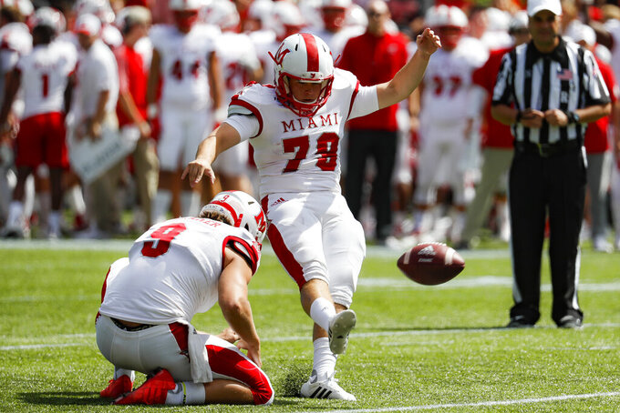Miami of Ohio place kicker Sam Sloman (79) kicks an extra point in the first half of an NCAA college football game against Cincinnati, Saturday, Sept. 14, 2019, in Cincinnati. (AP Photo/John Minchillo)