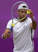 Matteo Berrettini of Italy serves to Andy Murray of Britain during their singles tennis match at the Queen's Club tournament in London, Thursday, June 17, 2021. (AP Photo/Kirsty Wigglesworth)