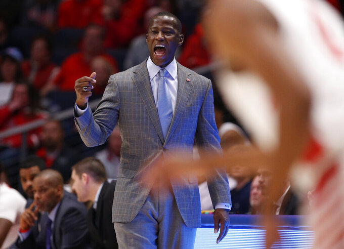 Dayton head coach Anthony Grant gives instructions during the first half of an NCAA college basketball game against North Florida, Monday Dec. 30, 2019, in Dayton. (AP Photo/Gary Landers)