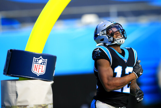 Carolina Panthers wide receiver D.J. Moore (12) celebrates his touchdopwn against the Tampa Bay Buccaneers during the first half of an NFL football game, Sunday, Nov. 15, 2020, in Charlotte , N.C. (AP Photo/Brian Blanco)