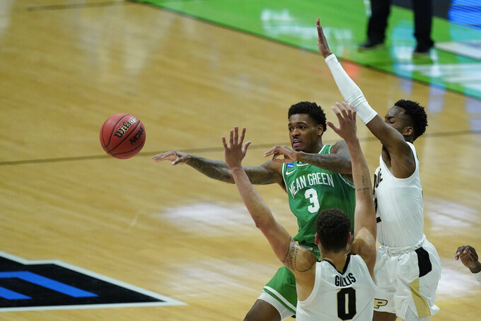 North Texas's Javion Hamlet (3) makes a pass against Purdue's Mason Gillis (0) and Eric Hunter Jr. (2) during the second half of a first-round game in the NCAA men's college basketball tournament at Lucas Oil Stadium, Friday, March 19, 2021, in Indianapolis. (AP Photo/Darron Cummings)