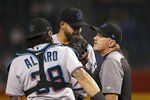 Miami Marlins pitching coach Mel Stottlemyre, right, visits Marlins starting pitcher Pablo Lopez, center, along with catcher Jorge Alfaro (38) during the first inning of a baseball game against the Arizona Diamondbacks, Monday, Sept. 16, 2019, in Phoenix. (AP Photo/Ross D. Franklin)
