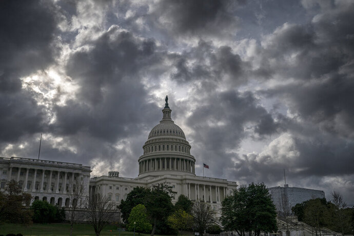 FILE - In this April 12, 2019, file photo morning clouds cover Capitol Hill in Washington. On Thursday, April 18, the Labor Department reports on the number of people who applied for unemployment benefits last week. (AP Photo/J. Scott Applewhite, File)