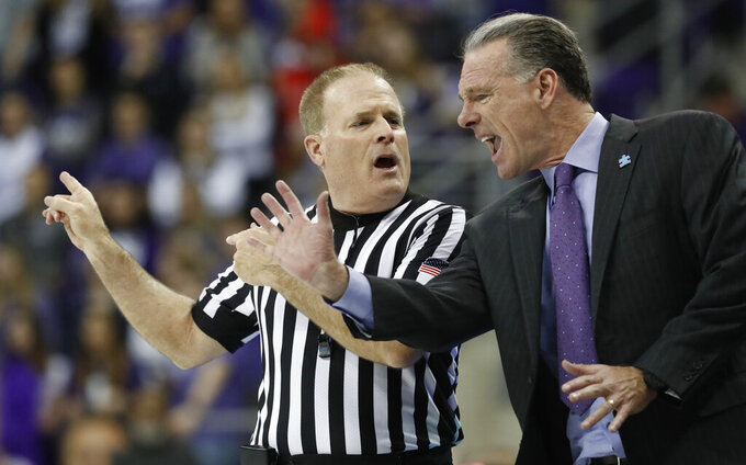 TCU head coach Jamie Dixon argues a call with official Gerry Pollard during the second half of an NCAA college basketball game against Oklahoma in Fort Worth, Texas, Saturday, Feb. 16, 2019. Oklahoma won 71-62. (AP Photo/LM Otero)