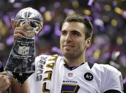 FILE - In this Feb. 13, 2013 file photo, Baltimore Ravens quarterback Joe Flacco (5) holds the Vince Lombardi Trophy after defeating the San Francisco 49ers 34-31 in the NFL Super Bowl XLVII football game in New Orleans.  A person with knowledge of the trade tells The Associated Press, Wednesday, Feb. 13, 2019, that the Denver Broncos have agreed to acquire Baltimore Ravens quarterback Joe Flacco in exchange for a fourth-round pick in this year's NFL draft. The person spoke on condition of anonymity because neither team announced the deal. (AP Photo/Matt Slocum, File)