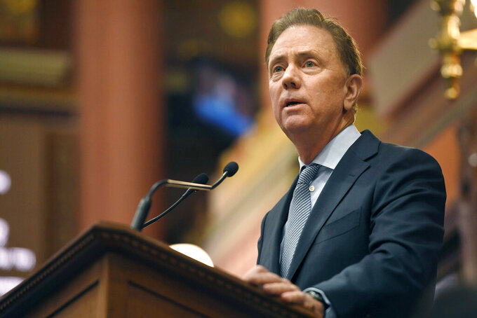 FILE- In this Feb. 5, 2020 file photo, Connecticut Gov. Ned Lamont delivers the State of the State address at the State Capitol in Hartford, Conn. Lamont said Thursday, July 16, 2020, that he would be reluctant to allow UConn's football team to travel to any state with a high coronavirus infection rate this fall. (AP Photo/Jessica Hill, File)