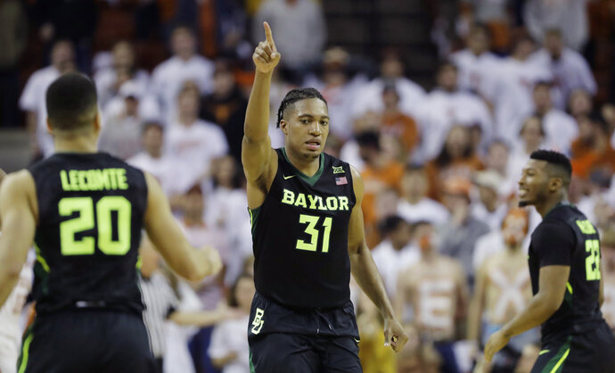 Baylor forward Terry Maston (31) celebrates a score against Texas in an NCAA college basketball game, Monday, Feb. 12, 2018, in Austin, Texas. Baylor won 74-73 in double overtime. (AP Photo/Eric Gay)