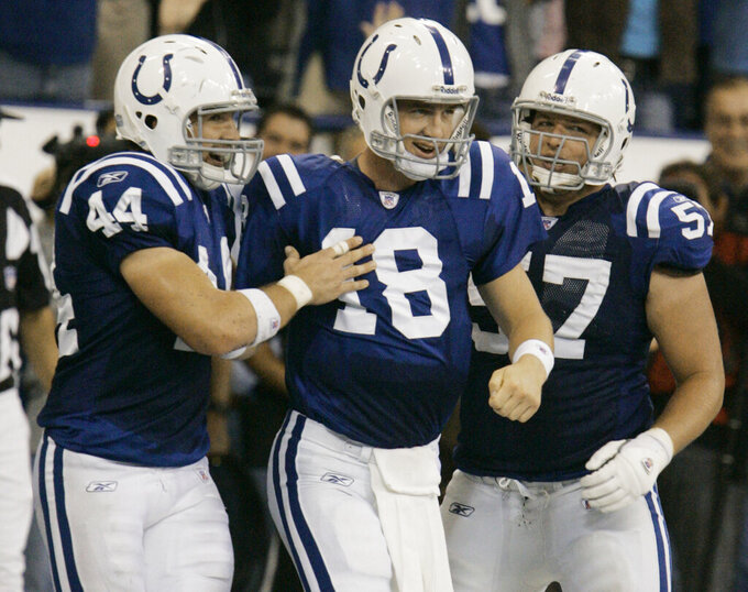FILE - In this Sept. 24 ,2006, file photo, Indianapolis Colts quarterback Peyton Manning (18) reacts with tight end Dallas Clark (44) and offensive guard Dylan Gandy (57) after scoring on a 2-yard touchdown run during the fourth quarter of a football game against the Jacksonville Jaguars in Indianapolis. Mannings 2006 Colts ranked 37th in voting by a nationwide panel of 59 football historians and media who regularly cover the NFL. (AP Photo/Darron Cummings, File)