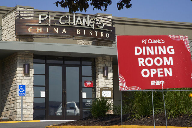 A P.F. Chang China Bistro restaurant is seen in Omaha, Neb., Tuesday, July 7, 2020. The restaurant is among big corporate names on the government's list of 650,000 recipients of coronavirus relief loans despite the controversy that prompted other high-profile businesses to return billions of dollars in loans. P.F. Chang's China Bistro said its loan of between $5 million and $10 million helped keep 12,000 workers employed as it transitioned its over 210 restaurants to take-out.  (AP Photo/Nati Harnik)