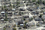 FILE - In this Wednesday, May, 1, 2019 file photo, widespread destruction caused by Cyclone Kenneth, which arrived just six weeks after Cyclone Idai, is seen from the air after it struck Ibo island north of Pemba city in Mozambique. These African stories captured the world's attention in 2019 - and look to influence events on the continent in 2020. (AP Photo/Tsvangirayi Mukwazhi, File)
