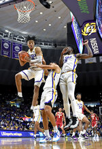 LSU forward Trendon Watford, left, comes down with the rebound in front of his teammates guard Skylar Mays, center, and forward Emmitt Williams, right, in the second half of an NCAA college basketball game against Alabama, Wednesday, Jan. 29, 2020, in Baton Rouge, La. LSU won 90-76. (AP Photo/Bill Feig)