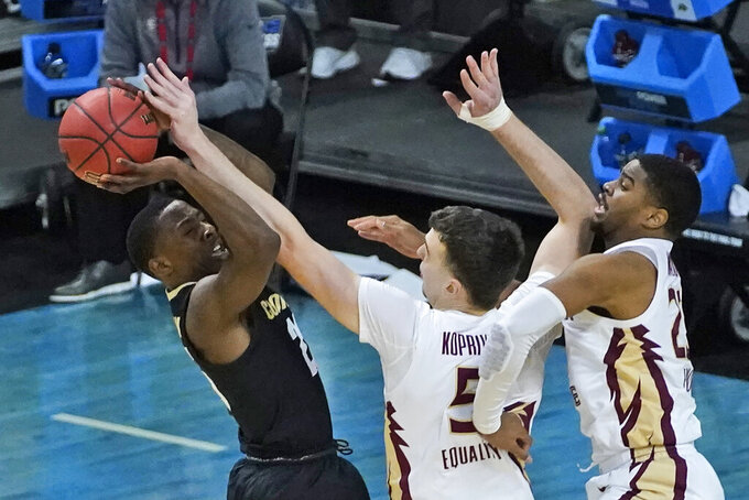 Florida State center Balsa Koprivica (5) blocks the shot of Colorado guard McKinley Wright IV, left, during the second half of a second-round game in the NCAA college basketball tournament at Farmers Coliseum in Indianapolis, Monday, March 22, 2021. (AP Photo/Charles Rex Arbogast)
