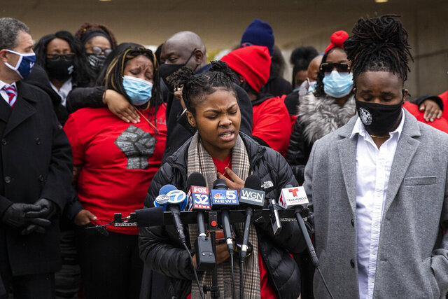 Clifftina Johnson (back, left), Tafara Williams' mother, cries as her daughter, Sasha Williams, sings during a press conference outside Waukegan's city hall complex, Tuesday morning, Oct. 27, 2020. Williams, 20, was wounded and her boyfriend, 19-year-old Marcellis Stinnette, was killed when they were both shot by a Waukegan police officer on Oct. 20. Three days after the incident, Waukegan Police Chief Wayne Walles announced that he had fired the officer, saying he'd committed