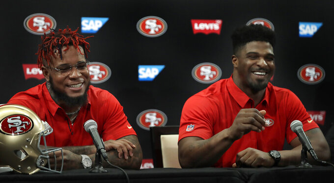 San Francisco 49ers' Kwon Alexander, left, and Dee Ford smile while answering questions during an NFL news conference Thursday, March 14, 2019, in Santa Clara, Calif. (AP Photo/Ben Margot)