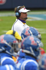 FILE - In this Saturday, Sept. 26, 2020, file photo, Mississippi head coach Lane Kiffin watches on from the sideline during the first half of an NCAA college football game Florida, in Oxford, Miss. Kiffin's first season at Mississippi has been anything but boring so far: Three straight shootouts, a quarterback putting up huge numbers and the nation's worst defense statistically.  (AP Photo/Thomas Graning, File)