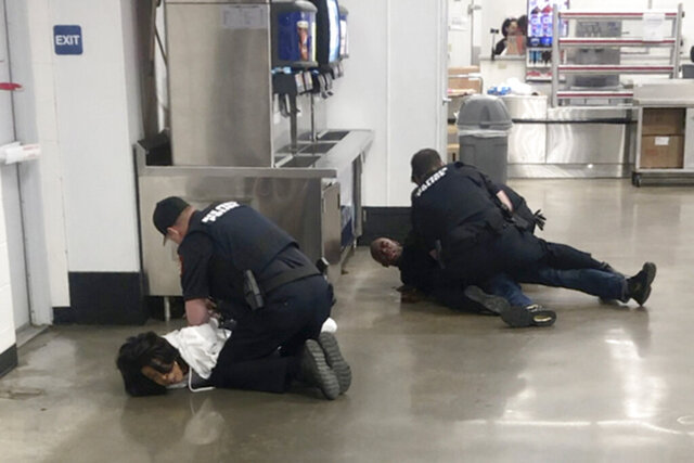 FILE - In this March 23, 2020, file frame grab taken from video, Marvia Gray, left and her son Derek Gray are arrested by white police officers at a Sam's Club store in Des Peres, Missouri. St. Louis County's prosecutor launched of an investigation Wednesday, May 20, 2020, after video showed white police officers forcefully arresting Gray and her son Derek. (Photo courtesy Action Injury Law Group via AP, File)