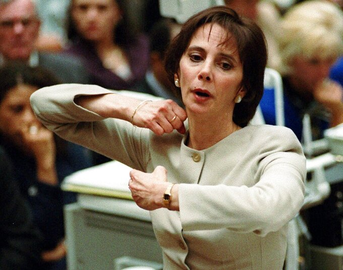 "FILE - In this Sept. 26, 1995, file photo, prosecutor Marcia Clark demonstrates to the jury how the murders of Nicole Brown Simpson and Ron Goldman were committed during her closing arguments in the O.J. Simpson double-murder trial in Los Angeles. Clark, the trial's lead prosecutor, quit law after the case, although she has appeared frequently as a TV commentator on high-profile trials over the years and on numerous TV news shows. She was paid $4 million for her Simpson trial memoir, ""Without a Doubt,"" and has gone on to write a series of crime novels. (Myung J. Chun/Los Angeles Daily News via AP, Pool, File)"