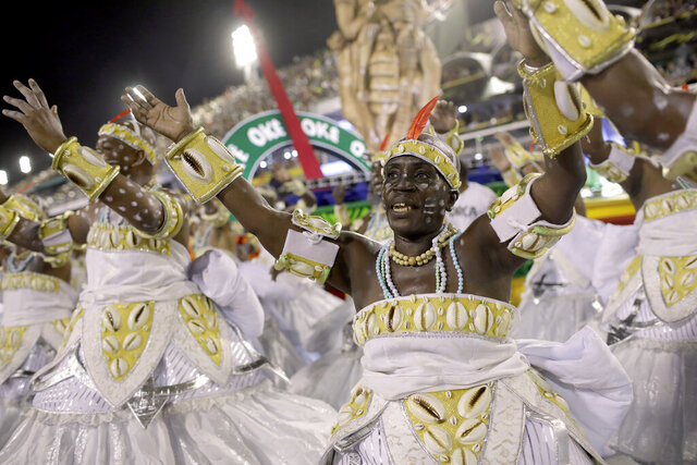 Performers from the Grande Rio samba school parade during Carnival celebrations at the Sambadrome in Rio de Janeiro, Brazil, Monday, Feb. 24, 2020. (AP Photo/Silvia Izquierdo)