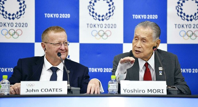 "John Coates, left, chairman of the IOC Coordination Commission for the 2020 Tokyo Olympics and Paralympics, Tokyo Olympic organizing committee President Yoshiro Mori, right, attend a press conference Thursday, May 23, 2019, in Tokyo. A top Olympic official has made a guarantee that should please world sports federations that are concerned that organizers of next year's Tokyo games might be cutting things that federations view as ""essential."" (Tsuyoshi Ueda/Kyodo News via AP)"