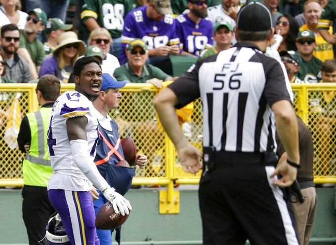 Minnesota Vikings' Stefon Diggs reacts after being called for a penalty for removing his helmet during the second half of an NFL football game against the Green Bay Packers Sunday, Sept. 15, 2019, in Green Bay, Wis. (AP Photo/Mike Roemer)