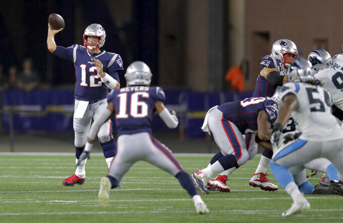 New England Patriots quarterback Tom Brady (12) passes to wide receiver Jakobi Meyers (16) in the first half of an NFL preseason football game against the Carolina Panthers, Thursday, Aug. 22, 2019, in Foxborough, Mass. (AP Photo/Charles Krupa)