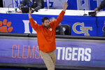 Clemson head coach Brad Brownwell reacts to a play during the second half of an NCAA college basketball game against Miami in the second round of the Atlantic Coast Conference tournament in Greensboro, N.C., Wednesday, March 10, 2021. Miami won the game 67-64. (AP Photo/Gerry Broome)