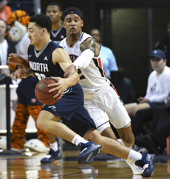 Auburn guard Bryce Brown (2) fouls North Florida guard Brian Coffey II (20) during the first half of an NCAA college basketball game Saturday, Dec. 29, 2018, in Auburn, Ala. (AP Photo/Julie Bennett)