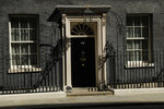 """The door of 10 Downing Street is seen in London, Tuesday, April 27, 2021. Britain's Prime Minister Boris Johnson has denied a press report which quoted him as allegedly saying he would rather see """"bodies pile high in their thousands"""" than impose a third national lockdown on the country. Media reports have claimed that Johnson made the comment in the fall of 2020, when his government imposed a second lockdown to combat a surge in coronavirus cases. (AP Photo/Matt Dunham)"""