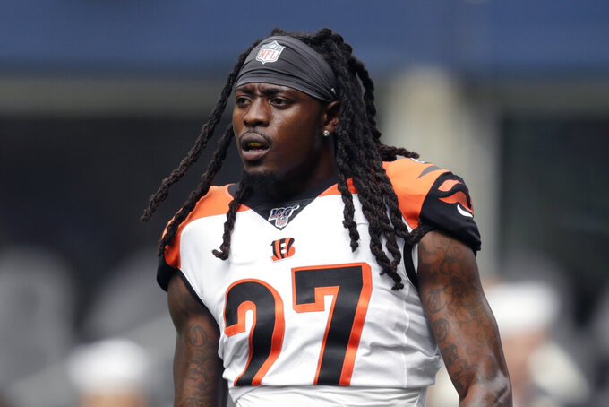 FILE - In this Sept. 8, 2019, file photo, Cincinnati Bengals cornerback Dre Kirkpatrick stands on the field during warmups before an NFL football game against the Seattle Seahawks in Seattle. The Bengals released starting cornerback Dre Kirkpatrick on Tuesday, March 31, 2020, another move to overhaul their secondary after a 2-14 season. Kirkpatrick was a first-round pick in 2012 and started 67 games in eight seasons. He missed 10 games last season with a knee injury. (AP Photo/Stephen Brashear, File)
