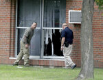 FILE - In this Saturday, Aug. 5, 2017 file photo, law enforcement officials investigate an explosion at the Dar Al-Farooq Islamic Center in Bloomington, Minn. The leader of an Illinois anti-government militia group who authorities say masterminded the 2017 bombing of a Minnesota mosque is to be sentenced Monday, Sept. 13, 2021, for several civil rights and hate crimes in an attack that terrified a community. (David Joles/Star Tribune via AP, File)