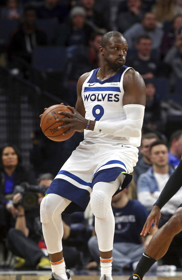FILE - In this file photo dated Monday, Feb. 25, 2019, Minnesota Timberwolves' Luol Deng in action suring an NBA basketball game, in Minneapolis, USA. The two-time NBA All Star, who became president of the South Sudan basketball federation after retiring as a player last year, Luol Deng wants to build up basketball in his native South Sudan that may mean him coaching the national team himself, as they prepare to play against Mali upcoming Saturday Nov. 28 2020.  (AP Photo/Jim Mone, FILE)