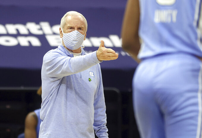 North Carolina coach Roy Williams talks with his players during the team's NCAA college basketball game against Virginia on Saturday, Feb. 13, 2021, in Charlottesville, Va. (Andrew Shurtleff/The Daily Progress via AP, Pool)