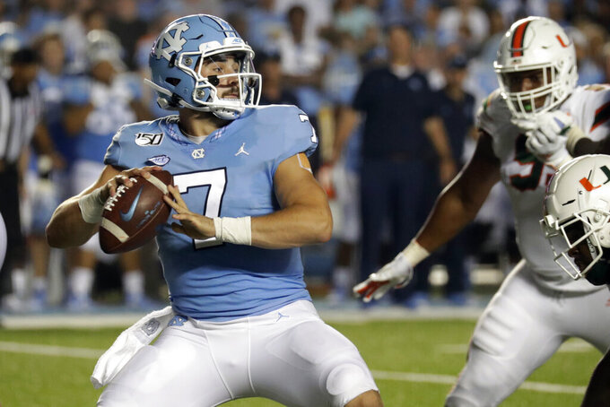 North Carolina's Sam Howell (7) looks to pass against Miami during the second quarter of an NCAA college football game in Chapel Hill, N.C., Saturday, Sept. 7, 2019. (AP Photo/Chris Seward)