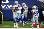 Dallas Cowboys' C.J. Goodwin (29) celebrates with Justin March (59) and others after recovering an onside kick in the second half of an NFL football game against the Atlanta Falcons in Arlington, Texas, Sunday, Sept. 20, 2020. (AP Photo/Michael Ainsworth)