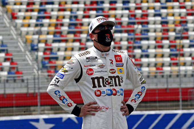 Driver Kyle Busch watches during qualifying for the NASCAR Cup Series auto race at Charlotte Motor Speedway Sunday, May 24, 2020, in Concord, N.C. (AP Photo/Gerry Broome)