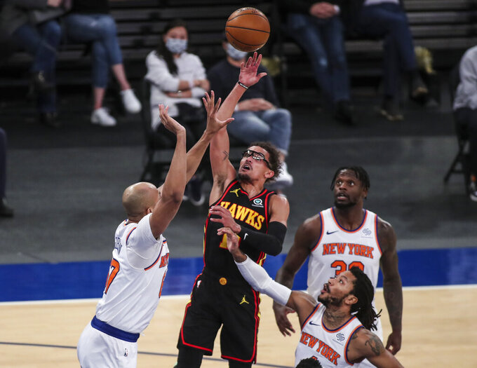 Atlanta Hawks guard Trae Young (11) shoots against the New York Knicks during the first quarter of an NBA basketball game Wednesday, April 21, 2021, in New York. (Wendell Cruz/Pool Photo via AP)