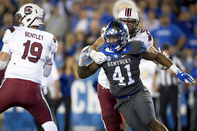 FILE - In this Sept. 29, 2018, file photo, Kentucky linebacker Josh Allen (41) rushes South Carolina quarterback Jake Bentley (19) during the second half of an NCAA college football game, in Lexington, Ky. Allen was named to The Associated Press Midseason All-America team, Tuesday, Oct. 16, 2018. (AP Photo/Bryan Woolston, File)