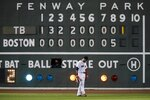 Boston Red Sox's Alex Verdugo stands in front of the left field scoreboard during the ninth inning of a baseball game against the Tampa Bay Rays, Wednesday, Aug. 12, 2020, in Boston. (AP Photo/Michael Dwyer)