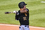 Pittsburgh Pirates' Yoshi Tsutsugo singles off Detroit Tigers relief pitcher Kyle Funkhouser, driving in two runs, during the seventh inning of a baseball game in Pittsburgh, Monday, Sept. 6, 2021. (AP Photo/Gene J. Puskar)