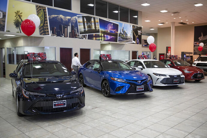 FILE - In this Feb. 14, 2019, file photo, Toyota sedans are displayed in a showroom at Puente Hills Toyota in Industry, Calif. This summer, the best deals will be found on a dealership's pre-owned lot. Because the price gap between new and used cars is widening, buying a used car now makes more sense than it did just a few years ago. (AP Photo/Jae C. Hong, File)