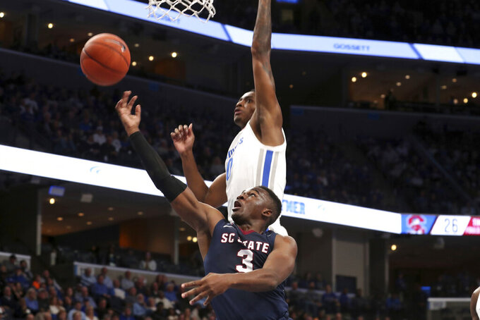 Memphis' D.J. Jeffries (0) and South Carolina State Rayshawn Neal (3) go for a rebound during the first half of an NCAA college basketball game Tuesday, Nov. 5, 2019, in Memphis, Tenn. (AP Photo/Karen Pulfer Focht)