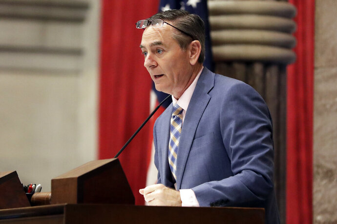 FILE - In this May 1, 2019 file photo, House Speaker Glen Casada, R-Franklin, stands at the microphone during a House session in Nashville, Tenn. Casada announced Tuesday, May 21, 2019 he plans to resign from his leadership post following a vote of no confidence by his Republican caucus amid a scandal over explicit text messages. (AP Photo/Mark Humphrey, file)