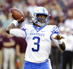 Kentucky quarterback Terry Wilson throws a pass against Texas A&M during the first half of an NCAA college football game Saturday, Oct. 6, 2018, in College Station, Texas. (AP Photo/Michael Wyke)