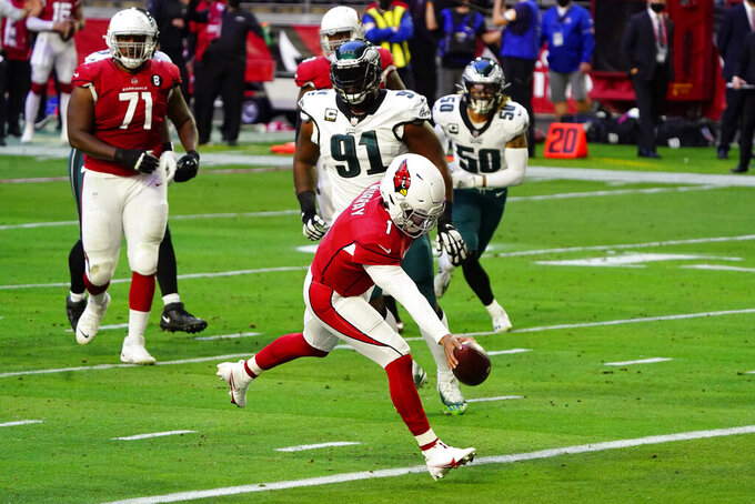 Arizona Cardinals quarterback Kyler Murray (1) scores a rushing touchdown against the Philadelphia Eagles during the first half of an NFL football game, Sunday, Dec. 20, 2020, in Glendale, Ariz. (AP Photo/Rick Scuteri)