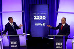 Democratic challenger Cal Cunningham, left, and U.S. Sen. Thom Tillis, R-N.C., talk during a televised debate Thursday, Oct. 1, 2020, in Raleigh, N.C. (AP Photo/Gerry Broome, Pool)