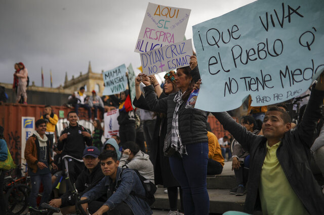 Anti-government demonstrators protest at Bolivar square in Bogota, Colombia, Sunday, Nov. 24, 2019. Authorities are maintaining a heightened police presence amidst scattered unrest in the aftermath of a mass protest that drew about 250,000 to the streets Thursday. (AP Photo/Ivan Valencia)