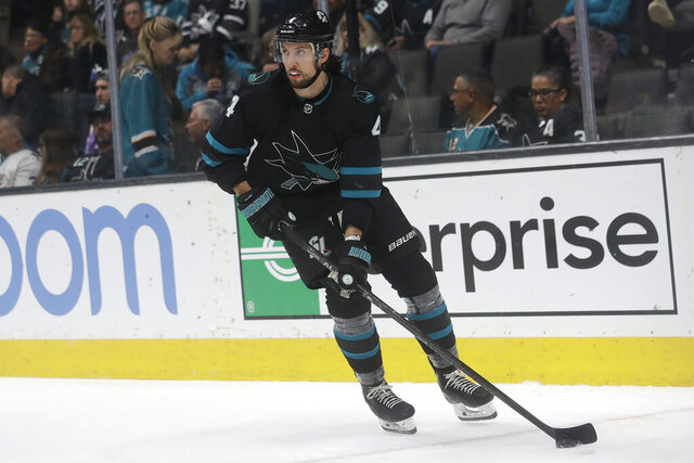 San Jose Sharks defenseman Brenden Dillon skates during the second period of the team's NHL hockey game against the Columbus Blue Jackets in San Jose, Calif., Thursday, Jan. 9, 2020. (AP Photo/Jeff Chiu)