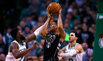 Milwaukee Bucks forward Giannis Antetokounmpo, center, is pressured by Boston Celtics guard Jaylen Brown, left, and Boston Celtics guard Shane Larkin, right, during the fourth quarter of Game 2 of an NBA basketball first-round playoff series in Boston, Tuesday, April 17, 2018. The Celtics defeated the Bucks 120-106. (AP Photo/Charles Krupa)