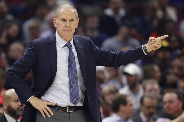 FILE - In this Friday, Dec. 20, 2019 file photo, Cleveland Cavaliers head coach John Beilein gives instructions to players in the first half of an NBA basketball game against the Memphis Grizzlies in Cleveland. Cavaliers first-year coach John Beilein will end a rough season by stepping down after 54 games, according to multiple reports Tuesday, Feb. 18, 2020.(AP Photo/Tony Dejak, File)